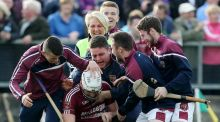 Cushendall's Conor Carson is mobbed by fans at the final whistle as his side won the reached the final of the Antrim SHC. Photo: John McIlwaine/Inpho