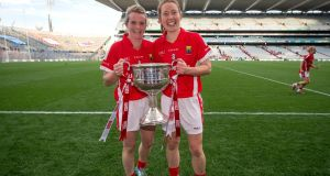 Cork's Briege Corkery and Rena Buckley celebrate with the Brendan Martin Cup in Croke Park. Photograph: Ryan Byrne/Inpho