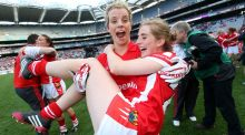 Cork's Valerie Mulcahy and Mairead Corkery celebrate at the end of the game as they beat Dublin to claim their fifth All-Ireland title in a row. Photo: Ryan Byrne/INPHO