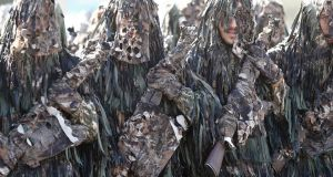 Camouflaged Iranian  soldiers march during the annual military parade marking the begging of the 1980 war with Iraq, in Tehran, Iran, 22 September 2015. Iran is marking the start of the eight-year-long war with Iraq. Photograph: Abedin Taherkenareh/EPA