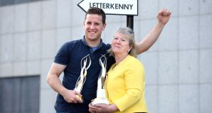 Anne McGowan with her son Patrick, as Letterkenny is the overall tidy towns winner during presentation of prizes in The Helix, Dublin. Photograph: Dara Mac Dónaill / The Irish Times