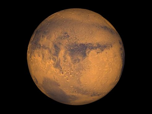 The planet Mars showing showing Terra Meridiani. Scientists say they have found definitive evidence of salty liquid water flowing on the planet's surface during wearmer months.  Photograph: Greg Shirah/Reuters/Nasa