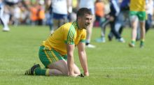 Donegal's Paddy McGrath collapses to the ground dejected at the end of this year's Ulster SFC final against Monaghan. Photograph: Inpho