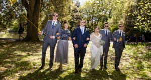 Mark Nally and Alison Garrett and part of their wedding party. Photograph: Suzanne Fahey of Circus Photography
