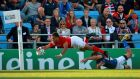 Tonga's Telusa Veainu makes a brilliant dive to touch down, only for the try to be disallowed after his left hand went into touch. Photograph: David Davies/PA