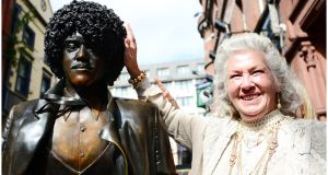 Philomena Lynott poses with the Phil Lynott statue in 2013. Photograph: Bryan O'Brien/The Irish Times