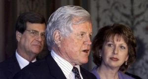 Edward Kennedy flanked by  President Mary McAleese and Senate Majority Leader Trent Lott talks to reporters on Capitol Hill Tuesday, May 16, 2000. Photo: AP Photo/Hillery Smith Garrison
