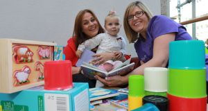 Early learning: Sandy Bolger with her daughter, Daisy, and Michelle Moore, a home visitor with the Parent Child Home Programme. Photograph: Nick Bradshaw