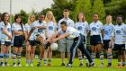 At the launch of the 2015 UCD International Ladies GAA Jersey are Doris Obialor and Ryan Wylie, watched by Jack McCaffrey and members of the UCD Ladies Football team, from left, Bethan Murphy Hand, Bo Zhang, Jasmine Ziabek, Claire O'Neill, Agata Blasiak, Precious Nwafor, Vicki Pesti and Doyinsola Ishola. Photograph:  Brendan Moran/Sportsfile