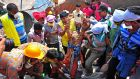 Rescue workers pull a garment worker alive from the rubble of the collapsed Rana Plaza building, in  Bangladesh in 2013. Photograph: Reuters