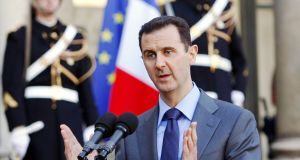 In this 2010 file photo, Syria president Bashar al-Assad addresses reporters following his meeting with French President Nicolas Sarkozy at the Elysee Palace in Paris, France. Photograph: AP Photo/Remy de la Mauviniere