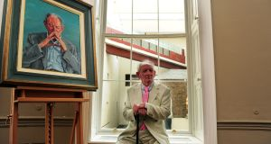 Brian Friel with a portrait of himself by Artist Mick O'Dea which was unveiled as part of the National Portrait Collection in The National Gallery Dublin. Photograph: Aidan Crawley/The Irish Times