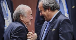 "Michel Platini's two million Swiss Franc payment from Fifa is the subject of criminal proceedings involving Sepp Blatter (left), with Platini's status described by the Swiss attorney general as ""in between a witness and accused person"". Photograph: Michael Buholzer/AFP photo"