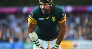Blood runs down the face of South Africa's lock Victor Matfield during the Pool B match against  Samoa. The forward will missthe Scotland match with a knee injury. Photograph: AFP Photo