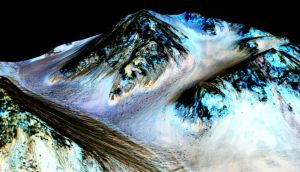 Dark streaks on the slopes of Hale Crater on Mars are believed to have been formed by seasonal flow of water. Photograph: EPA/Nasa/ JPL-Caltech/University of Arizona