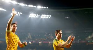 Australia's Rob Simmons and Bernard Foley celebrate after Australia's win. Photograph: James Crombie/Inpho