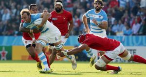 Leonardo Senatore of Argentina breaks through the Tonga defence during the Rugby World Cup 2015 Pool C match between Argentina and Tonga at Leicester City Stadium. Photograph: EPA