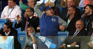 Former Argentinian soccer player Diego Maradona cheers on his team. Photograph: EPA