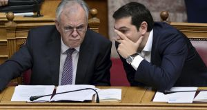 Greek prime minister Alexis Tsipras (right):  has told his electorate he will comply with the terms of the three-year bailout. Photograph:   Louisa Gouliamaki