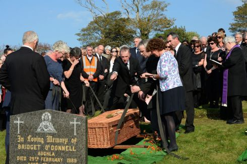 Family and friends gather at the burial ceremony of Brian Friel, at Glenties Cemetery, Co Donegal. Photograph: Dara Mac Donaill/The Irish Times