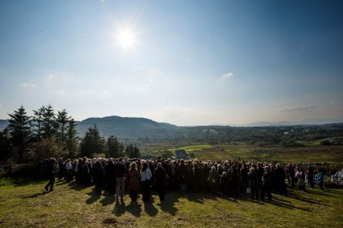Family and friends gather to pay their respects to Brian Friel, at Glenties Cemetery. He is survived by his wife Anne and children Mary, Judy, Sally and David. Photograph: Dara Mac Donaill/The Irish Times