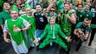Ireland fans make there way through the Westfield Shopping Centre outside the Olympic Stadium. Photograph: James Crombie/Inpho