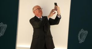 Minister for Foreign Affairs Charlie Flanagan taking selfie. Applications can be made through smartphone app. Photograph: MerrionStreet