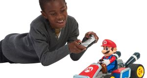 "RC Mario Kart 7 (€79.99 each):  Mario has come to life - or at least his kart has. With Bowser, Yoshi or Mario at the helm your small ones will be able to send these cars hurtling around corners and the ankles of  big people at breakneck speed. The carts come with ""body-tilt technology"" which sounds completely makey-uppy to us but hey! If it stops the cars crashing and smashing into little pieces it's okay by us."