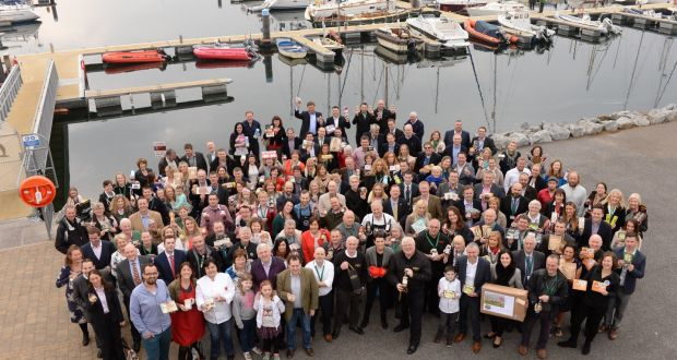 Finalists in the Blas na hÉireann awards gather at Dingle harbour with their products. Photograph: Don MacMonagle