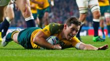 Australia's outhalf Bernard Foley scores a try against England. Photograph: Andrew Winning/Livepic