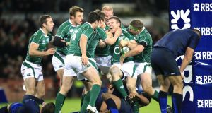 "Gordon D'Arcy celebrates with his  team-mates after scoring against France after his return from injury  in 2009. ""The lads mobbed me because they understood what their team-mate had been through, where he had to climb from to wear a green jersey again."" Photograph: Peter Muhly/AFP"
