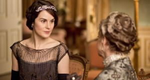 Headband alert: Michelle Dockery as Lady Mary and Maggie Smith as Violet in 'Downton Abbey'