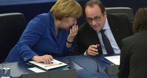 German chancellor Angela Merkel and French president Francois Hollande during their joint address at the European Parliament  in Strasbourg, France.  Photograph: Patrick Hertzog/AFP/Getty Images