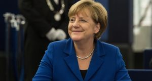 "German chancellor Angela Merkel has stood firm on her liberal asylum policy, calling it a ""task of historical proportions"" in Strasbourg. Photograph: Patrick Seeger/EPA"