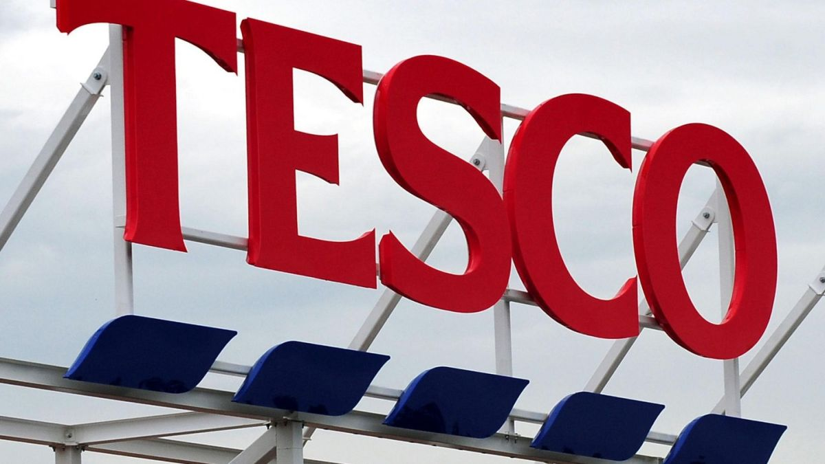 Tesco s profits halve as it struggles with turnaround