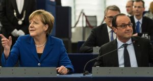 German chancellor Angela Merkel and French president François Hollande at the European Parliament in Strasbourg on Wednesday. Photograph: Patrick Seeger/EPA