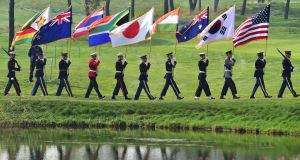 United Nations Command honour guards carry flags of the competing nations ahead of the first round of foursome matches at the 2015 Presidents Cup at the Jack Nicklaus Golf Club in Incheon, west of Seoul. Photograph: Getty Images