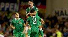 Ireland's Shane Long celebrates with Robbie Brady and Wes Hoolahan at the end of the game. Photograph:  Donall Farmer/Inpho