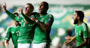 Northern Ireland's Steven Davis celebrates scoring the first goal of the game.