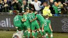 Republic of Ireland  players congratulate goalscorer Shane Long after their victory over Germany: Photograph: INPHO/Morgan Treacy