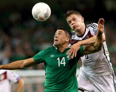 Germany's Matthias Ginter and Republic of Ireland's Jonathan Walters  battle for the ball. Photograph: Brian Lawless/PA Wire.