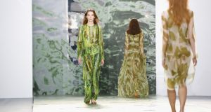 1. The colour green. Particularly notable earlier in London at Jasper Conran whose whole collection was green in all its shade variations. But also green suede jackets at Dior, at Rick Owens, loose silk trenches at Celine, Sphere One's leaf  green knits, Danielle Romeril's palm prints and Stella McCartney's zany green and white stripes. Other colours were earthy too like putty and henna (see Valentino) <br>