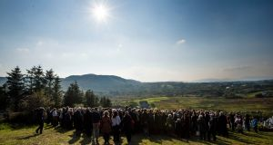 SUNDAY: Family and friends gather at the burial ceremony of Brian Friel, at Glenties Cemetery, Co Donegal. Photograph: Dara Mac Donaill/The Irish Times