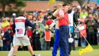 Bill Haas of the United States shakes hands with Sang-moon Bae of South Korea and the International team after Haas won the final match on the 18th green to help his side retain the title. Photograph:  David Cannon/Getty Images