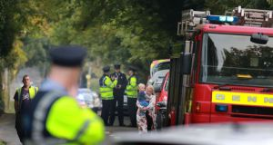 CARRICKMINES FIRE: Emergency services attend the scene. Photograph: Nick Bradshaw