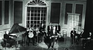 Ceoltóirí Chualann on stage for Ó Riada sa Gaiety in March 1969, (l–r): Seán Ó Riada, Peadar Mercier, Éamon de Buitléar, Martin Fay, Seán Keane, John Kelly, Seán Potts, Michael Tubridy and Paddy Moloney. Seán Ó Sé is at the front. Photograph: Gael Linn