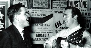 Seán O Sé with Liam Clancy at a Saturday night dance at the Arcadia Ballroom in 1962. Photograph:  Irish Examiner