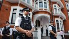 Image from August 2012 of British police outside the  Ecuadorian embassy  in Knightsbridge,  London, where Wikileaks founder Julian Assange had recently taken  refuge to avoid extradition to Sweden over sex allegations. File photograph: Dominic Lipinski/PA Wire