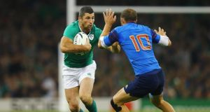 Rob Kearney of Ireland hands off Frederic Michalak of France at the Millennium Stadium on Sonday. Photograph: Richard Heathcote/ World Rugby via Getty Images