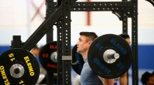 New Zealand's outhalf Dan Carter takes part in a gym session at Swansea University in south Wales. Photograph: Getty Images